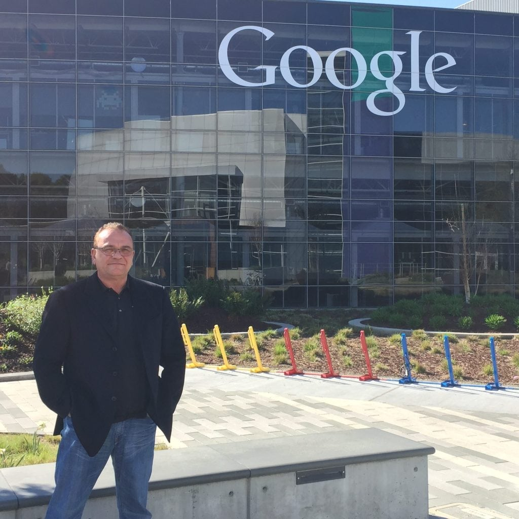 SEO Inc.'s founder and CEO stands in front of the Googleplex, Google's headquarters.