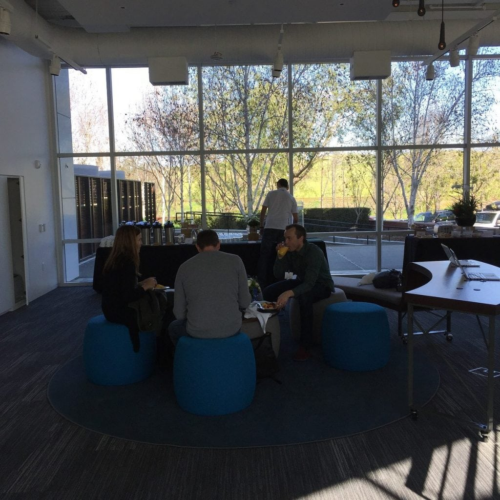 SEO Inc.'s clients sit on round, blue furniture and eat in Google's lunchroom.