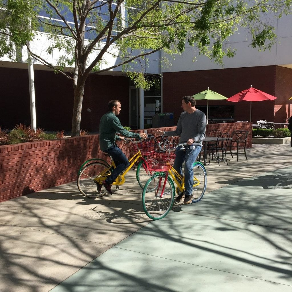 Two of SEO Inc.'s clients riding bicycles.