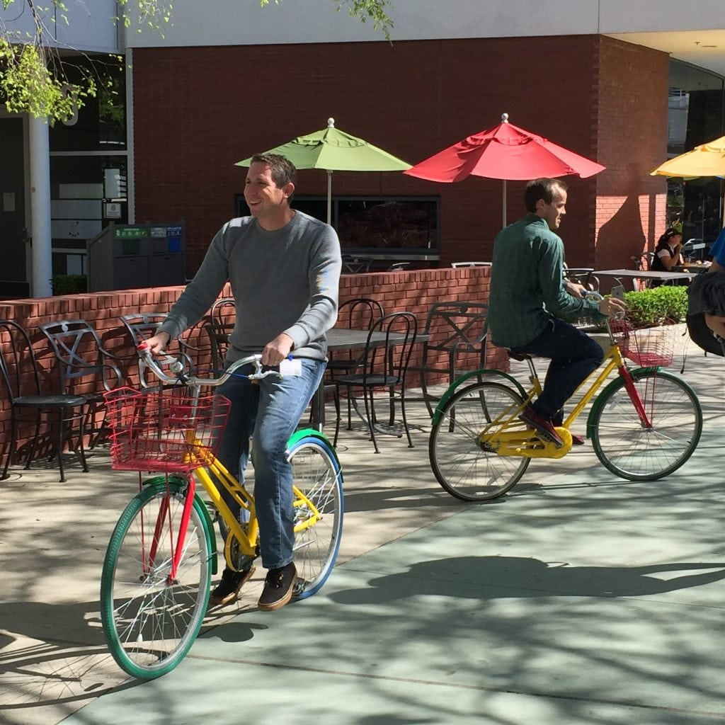 Two of SEO Inc.'s clients ride Google bicycles .