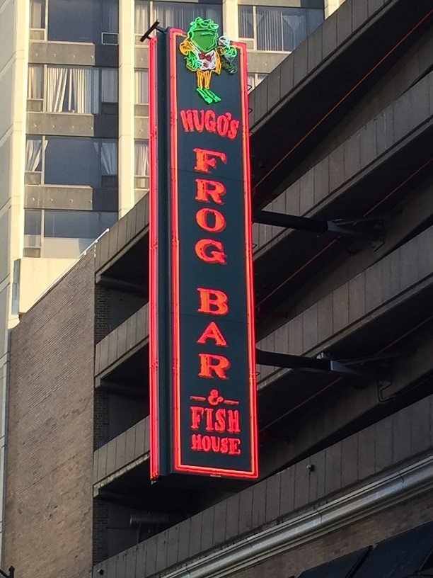 The signage for Hugo's Frog Bar and Fish House in Chicago, Illinois.