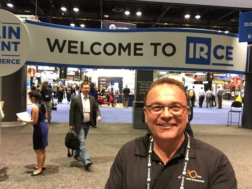 SEO Inc.'s CEO Garry Grant smiling in front of the banner for IRCE Chicago.